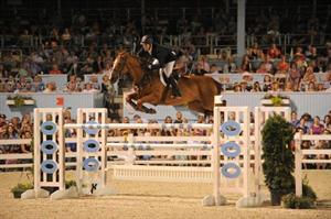 McLain Ward and Rothchild won the first leg of the THIS Triple Crown Challenge at the Devon Horse Show; photo by The Book LLC