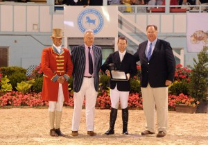 McLain Ward receives award for winning the first leg of the Triple Crown Challenge from THIS Michael Taylor and Bill Weeks at the Devon Horse Show; photo by The Book LLC